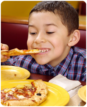Photo of a Kid Eating Pizza
